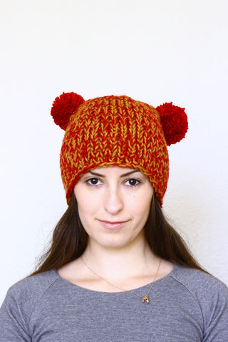 Knit hat with two poms, knit skull hat in red orange color