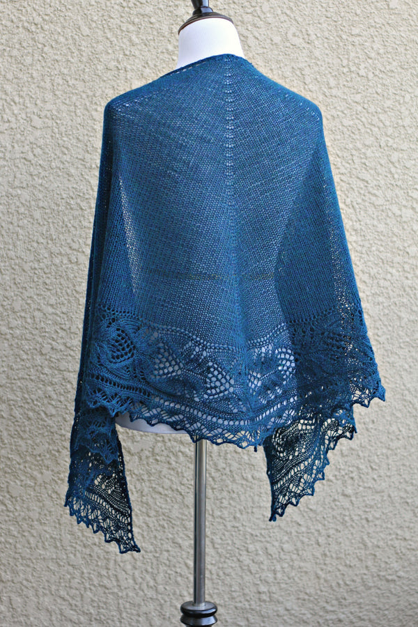 Knit shawl with lace border