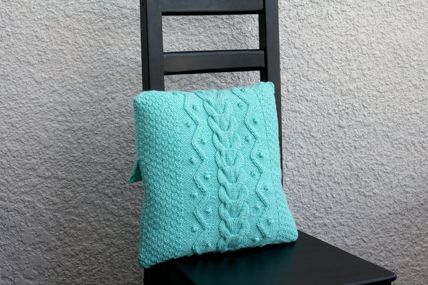 Knit cabled pillow cover with nupps for home decor
