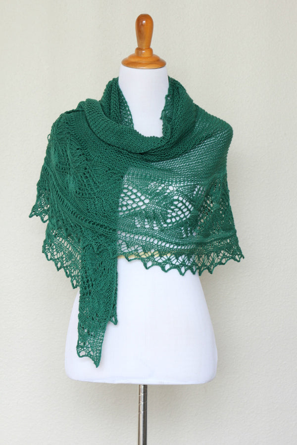 Knit shawl with laced border in forest green color
