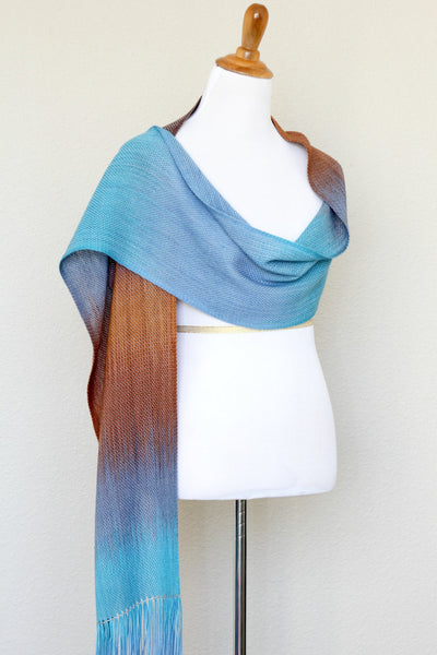 Woven scarf in turquoise, blue and brown colors