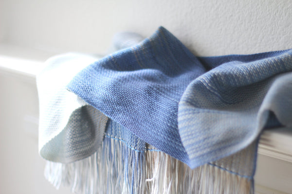 Blue and white woven scarf
