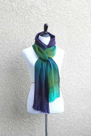 Green and purple woven scarf