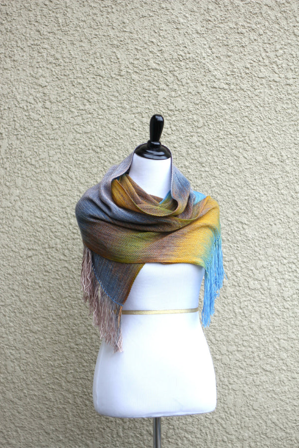 Woven scarf in yellow, blue and brown colors