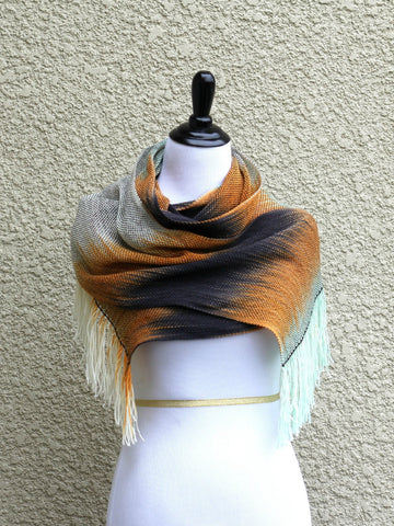 Hand woven scarf in white, orange, black and mint colors