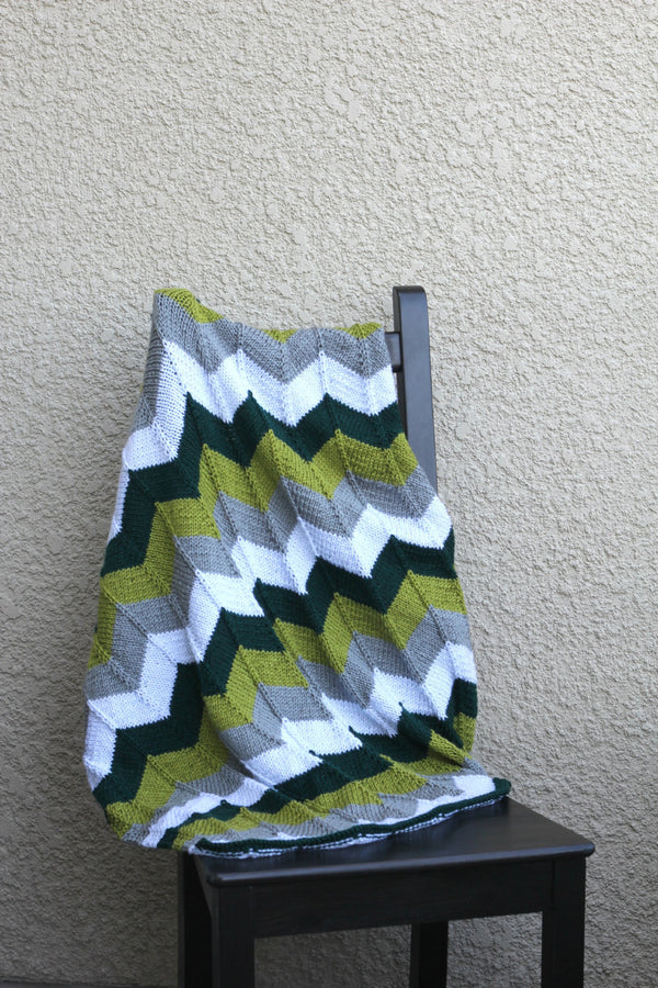 Green and grey baby blanket
