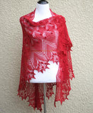 Knit lace shawl in pink coral color with nupps