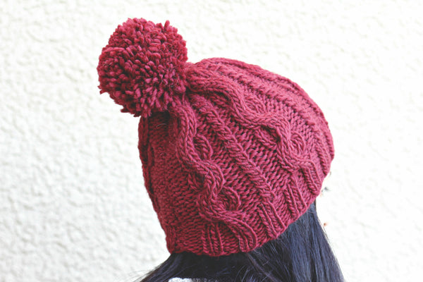 d5d0902a097 Knit hat for women in wine red color with cables and pompom – KGThreads