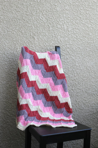 Pink knit baby blanket