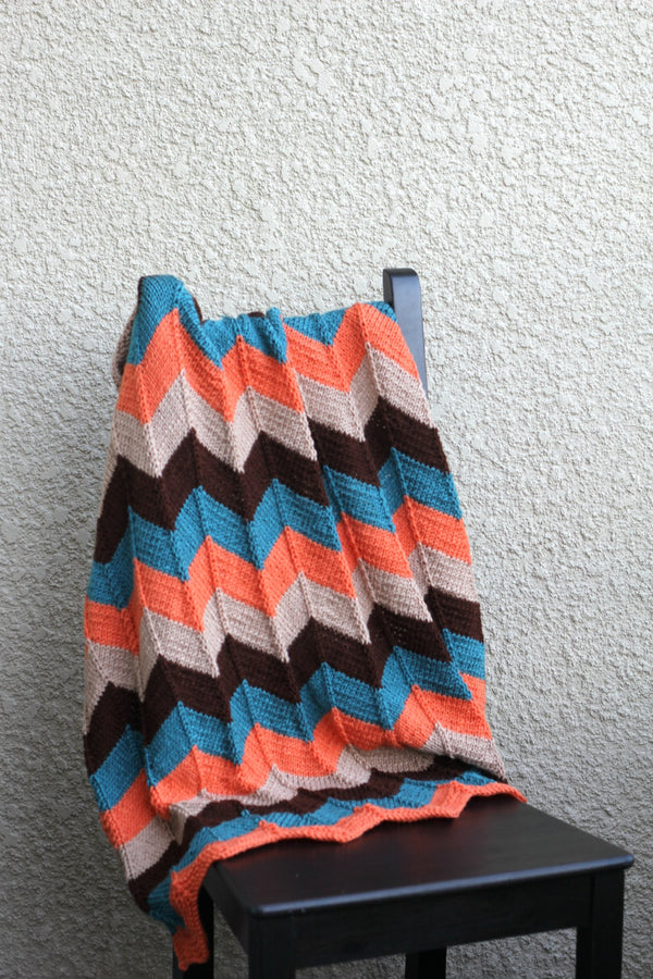 Orange and teal baby blanket