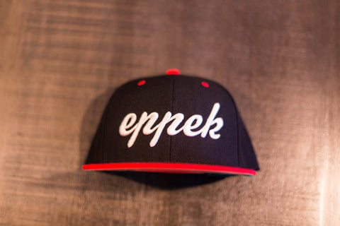 Red/black snapback with white 3d embroidered logo