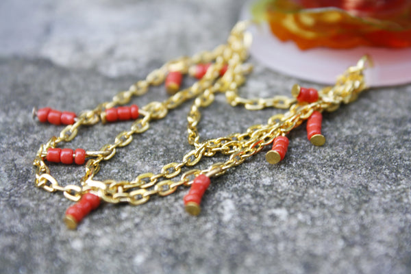 eco-friendly-brooch-in-red-with-gold-chain
