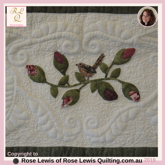 "Trapunto Feathers & Appliqued Rosebuds & Wren. This is within the outer border of ""A Caterpillars Dream"" Quilt."