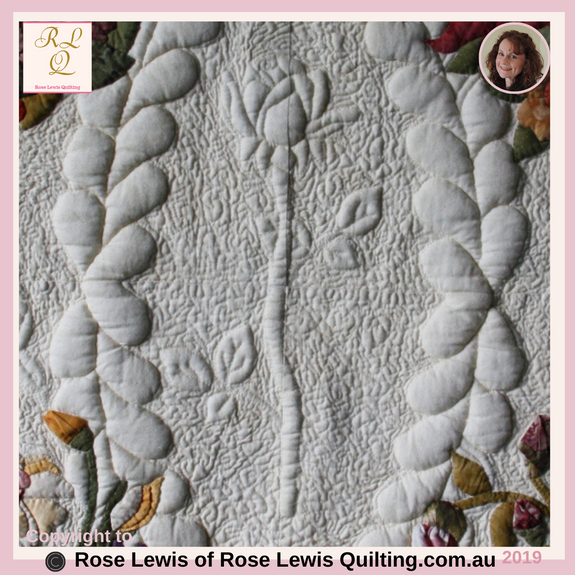 "Trapunto Quilted Rose. This is from the very centre of my ""A Caterpillars Dream"" quilt. - Best of Show Quilt"