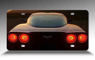 Corvette Black C6 Front Metal License Plate Sign with a View of Rear Tail Lights