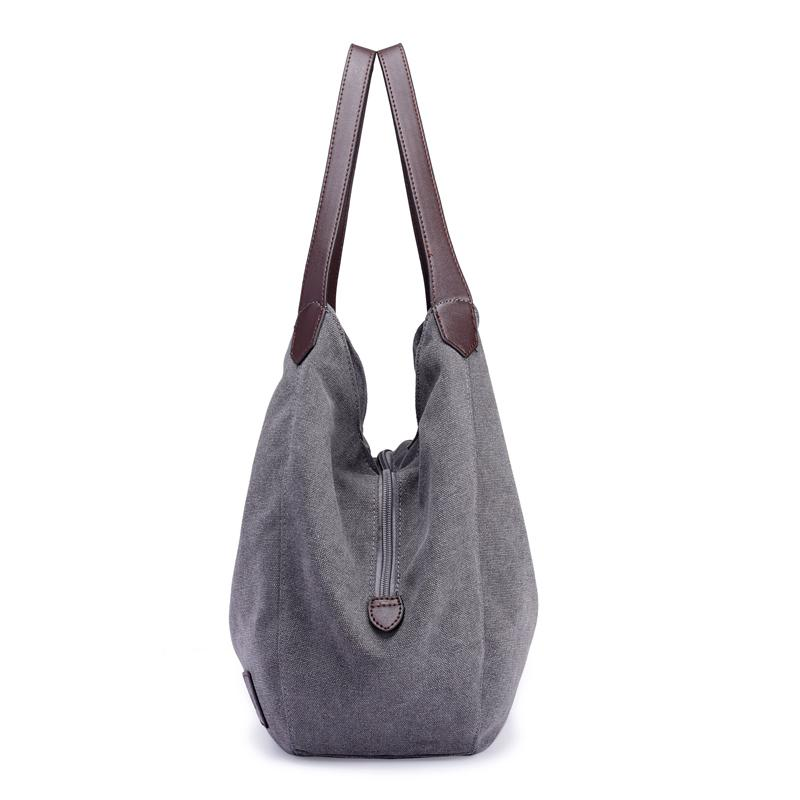 Side View Of Gray Canvas Hobo Bag Shoulder Tote Brown Long Handles Two Sides Pockets