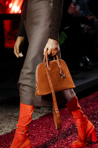 649cd5c415b3 The evergreen bolide bag was presented in a suede version with studded  strap.