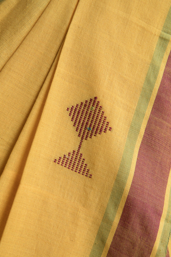 Maroon Fish on Yellow Saree