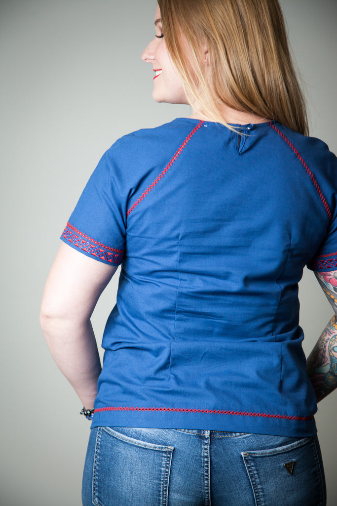 Blue top with red embroidery accent
