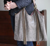 Ella Moss Wanderlust North South Leather Tote Taupe shown on model carrying bag