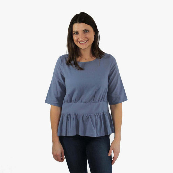 Women's Short Sleeve Ruffle Top in Dusty Blue front of shirt shown on model
