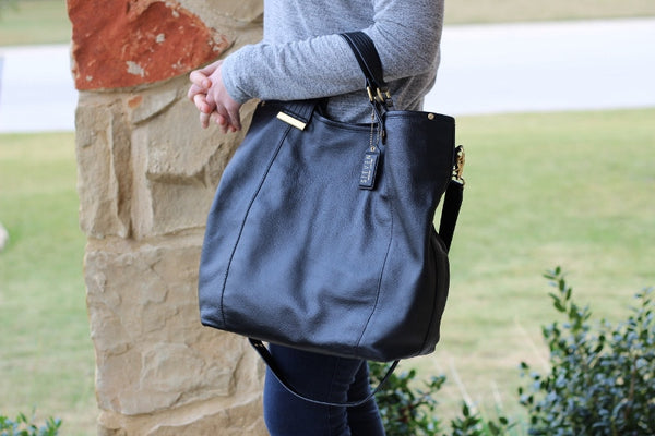 Steve Madden Noho Leather Tote Bag in Black shown on model