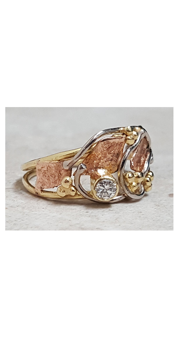 Asymmetrical design ring in Rose, yellow and white gold with diamond accent