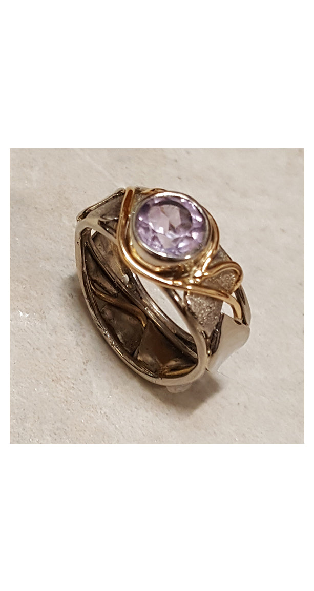 Band style ring with bezel set amethyst