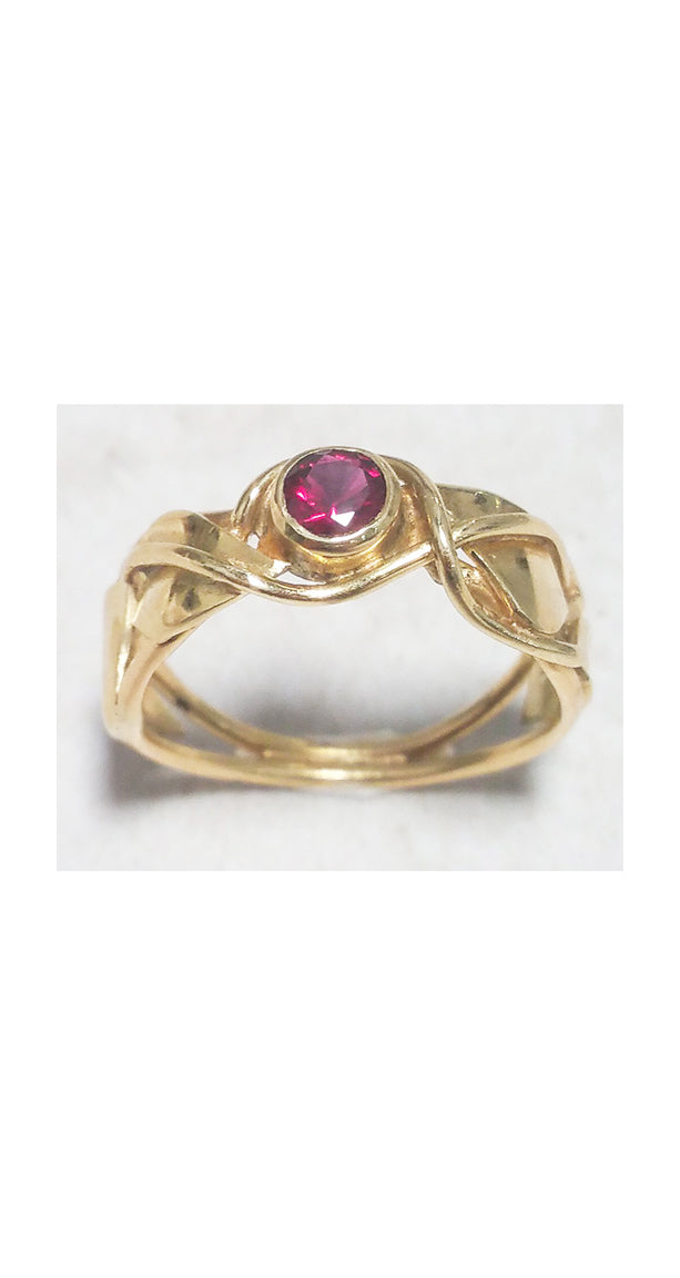 SOLD: Band style ring with bezel set garnet