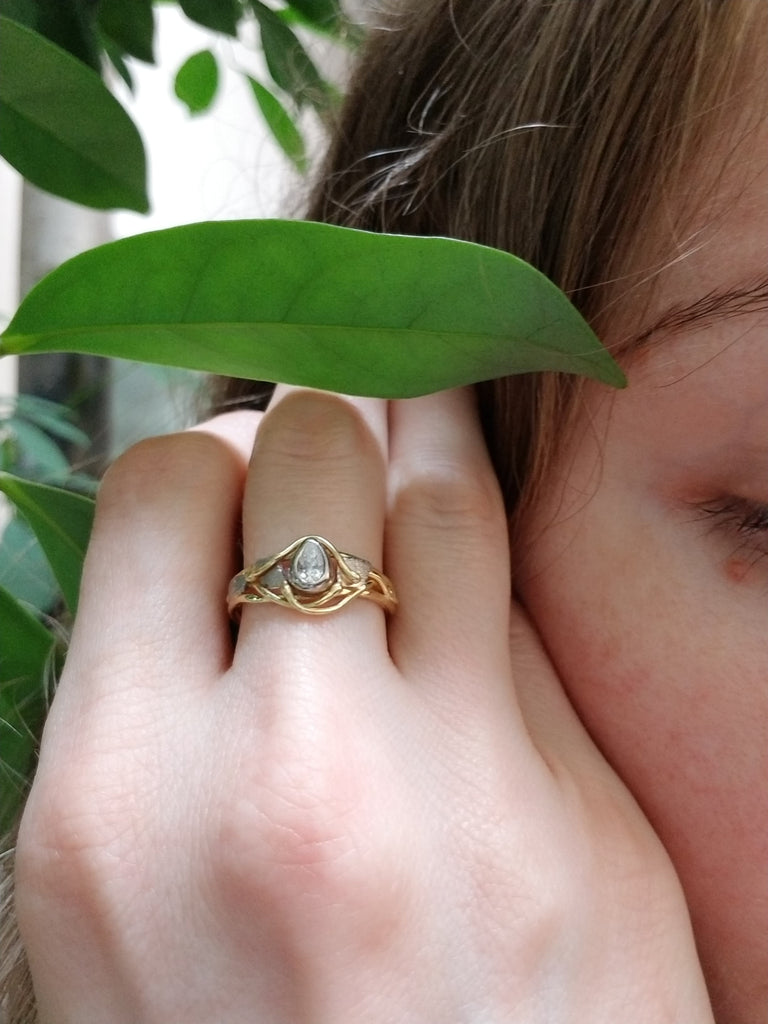Asymmetrical diamond ring in yellow and white gold