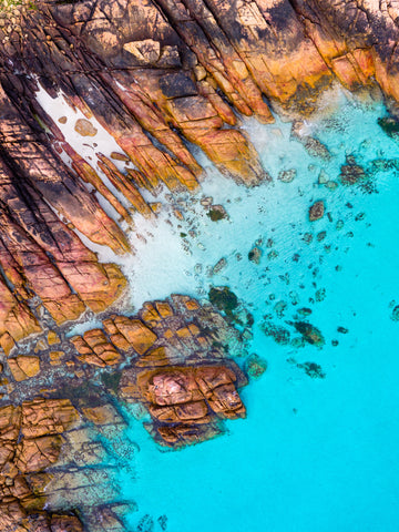 Meelup, Dunsborough, South Western Australia. Clean blue water and orange rocks.