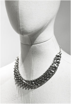 Interwoven metal plates neck-piece