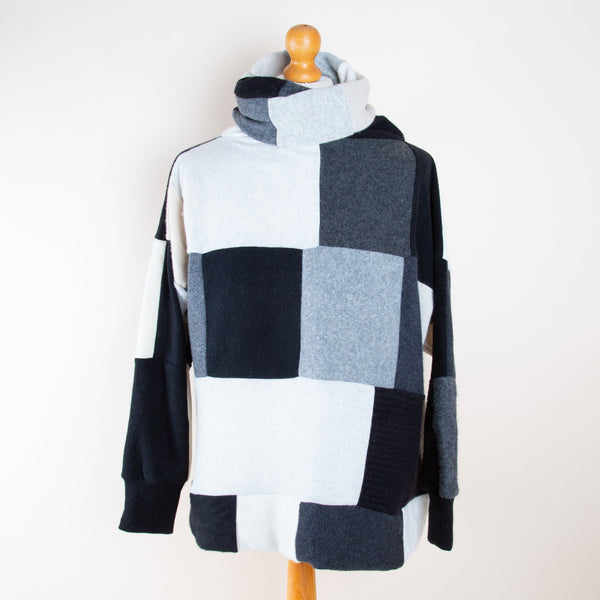 Monochrome Cashmere Roll Neck Jumper by Turtle Doves