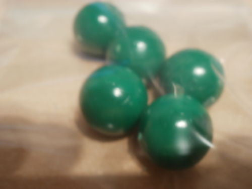 Green 19mm diameter balls, solid PVC. Will not float, games counters in schools.