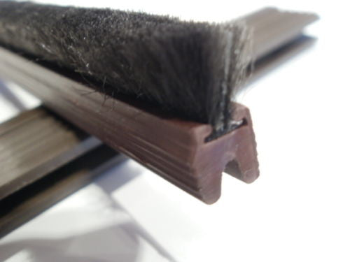 1.05 mt brown molar smaller ribbed rebate seals. 6 mm wide kerf  9 mm deep, keff sealed with 9.5 mm finned black brush pile