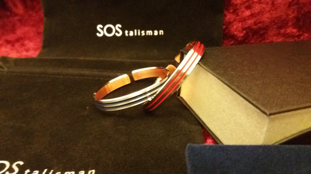 Copper bangle made of rhodium with coloured stripe.  Red, dark blue and black   code 915 and chose colour