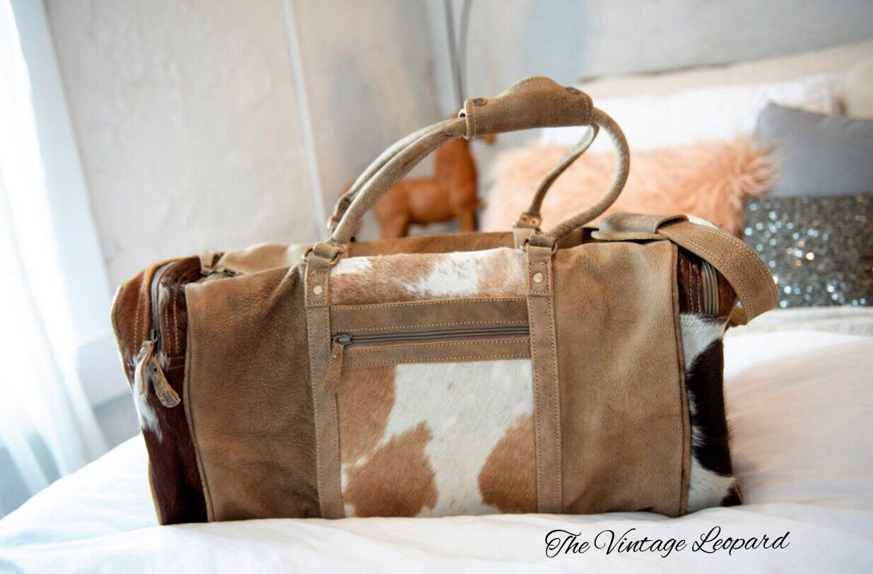 Myra Cowhide Leather Cinnamon Traveler Duffle Bag The Vintage Leopard Every bag is truly myra, a treat for nature lovers, is an endeavor to bring style, elegance, sophistication and quality. myra cowhide leather cinnamon traveler duffle bag
