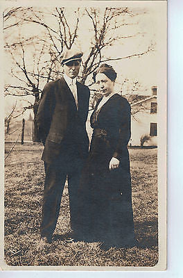 Vintage Postcard of a Couple Standing in Front of House $10.00