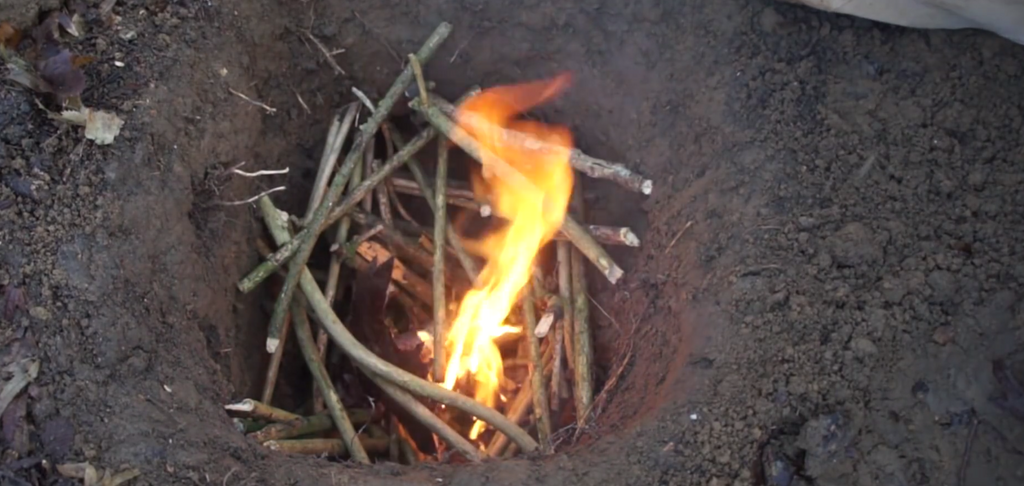 stack kindling wood into your smokeless fire hole