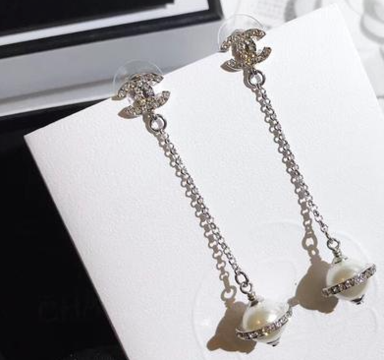 Chanel cosmo dangle earrings