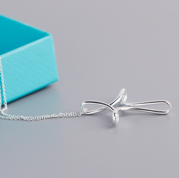 Tiffany &Co. cross pendant necklace