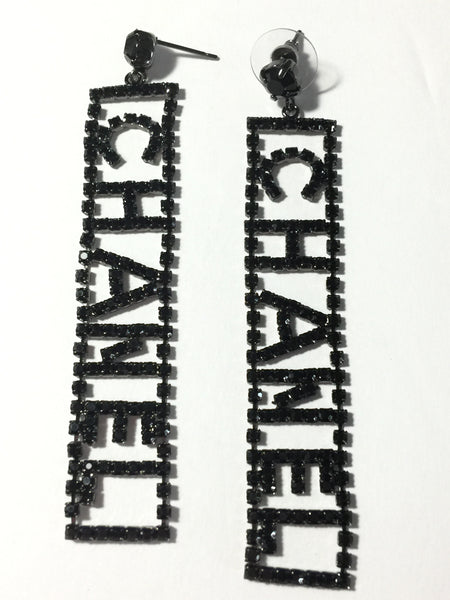 Chanel letter crystal dangle earrings in transparent or black