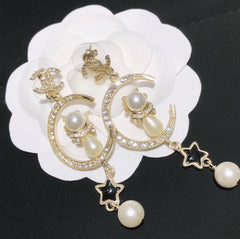 Chanel moon star long drop dangle earrings