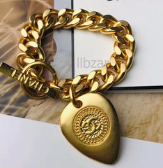 Chanel heart tag gold chain bracelet