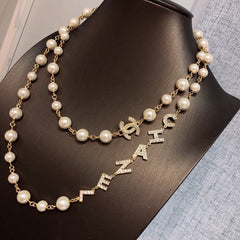 CHANEL LETTERS D LONG PEARL NECKLACE CRYSTAL