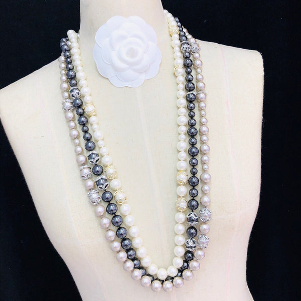 CHANEL CAMELLIA LONG PEARL NECKLACE