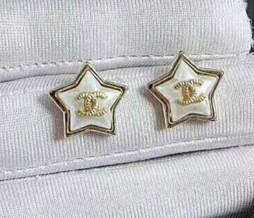 Chanel white star earring studs