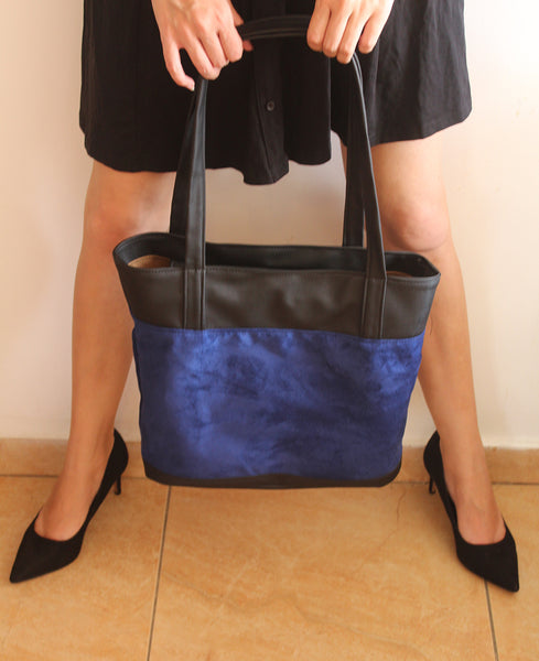 Classic blue tote bag with zipper closer.