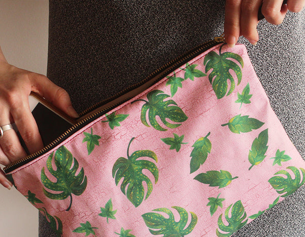 Modern clutch bag, a simple and classic clutch bag, with a print of green leaves on pink background, by Petrushka studio