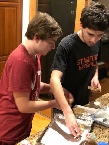 two boys in a kitchen make cookies
